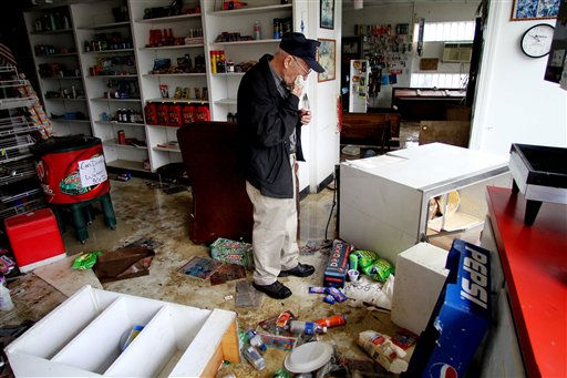 "<div class=""meta ""><span class=""caption-text "">Roy Stocks survey the damage in his store, Roy's Service Center, after floodwaters receded in  Windsor, N.C., Sunday, Oct. 3, 2010.  (AP Photo/ Jim R. Bounds)</span></div>"