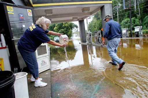 Beverly Bracy, left, cleans up at Roy&#39;s Service Center after floodwaters receded in Windsor, N.C., Sunday, Oct. 3, 2010.   <span class=meta>(AP Photo&#47; Jim R. Bounds)</span>
