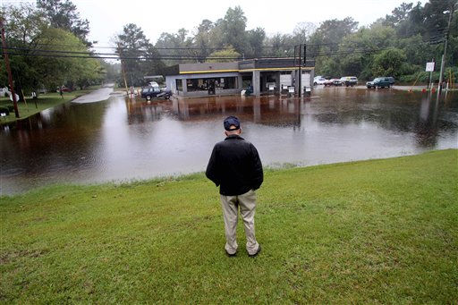 Roy Stocks surveys the damage of his store, Roy&#39;s Service Center, due to floodwaters in Windsor, N.C., Sunday, Oct. 3, 2010.   <span class=meta>(AP Photo&#47; Jim R. Bounds)</span>
