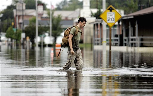 AJ Lanier walks through flood waters in Windsor, N.C., Sunday, Oct. 3, 2010.   <span class=meta>(AP Photo&#47; Jim R. Bounds)</span>