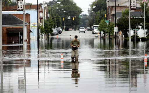 "<div class=""meta ""><span class=""caption-text "">A.J Lanier walks through flood waters in Windsor, N.C., Sunday, Oct. 3, 2010.  (AP Photo/ Jim R. Bounds)</span></div>"