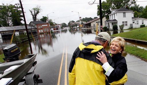 North Carolina Gov. Beverly Perdue, right, hugs Windsor Mayor James Hoggard during a tour of flooded downtown Windsor, N.C., Sunday, Oct. 3, 2010. <span class=meta>(AP Photo&#47; Jim R. Bounds)</span>