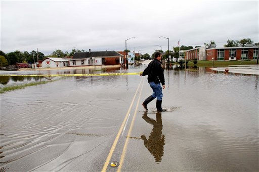 "<div class=""meta ""><span class=""caption-text "">Windsor Police Officer Sgt. R.L. Morris blocks of King Street as floodwaters still stand in Windsor, N.C., Monday, Oct. 4, 2010.  (AP Photo/ Jim R. Bounds)</span></div>"