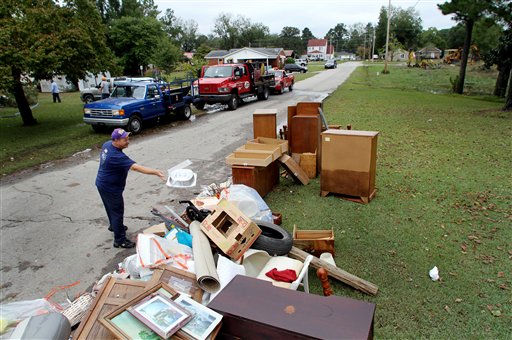 "<div class=""meta ""><span class=""caption-text "">Kenny Perry removes damaged belongings from the flooded home of his mother, Carolyn Perry, after floodwaters receded in Windsor, N.C., Monday, Oct. 4, 2010.  (AP Photo/ Jim R. Bounds)</span></div>"