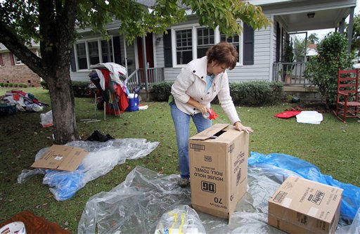 Susan Wilkerson helps box up belongings for a friend who&#39;s home was damaged by floodwaters in Windsor, N.C., Monday, Oct. 4, 2010.  <span class=meta>(AP Photo&#47; Jim R. Bounds)</span>