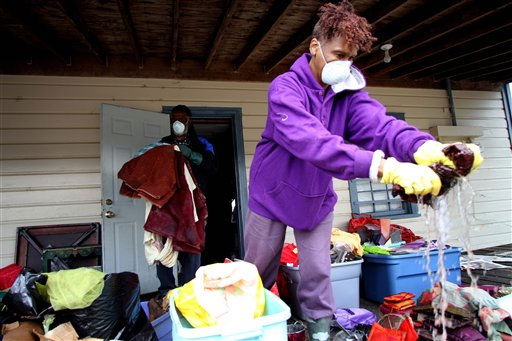 Akosua Bandele, right, and Marvin Kelly clean out their storage unit after floodwaters receded in Windsor, N.C., Monday, Oct. 4, 2010.  <span class=meta>(AP Photo&#47; Jim R. Bounds)</span>