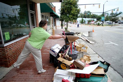 "<div class=""meta ""><span class=""caption-text "">Clara Phelps cleans out J.B. Cherry Agency after floodwaters receded in Windsor, N.C., Monday, Oct. 4, 2010.  (AP Photo/ Jim R. Bounds)</span></div>"