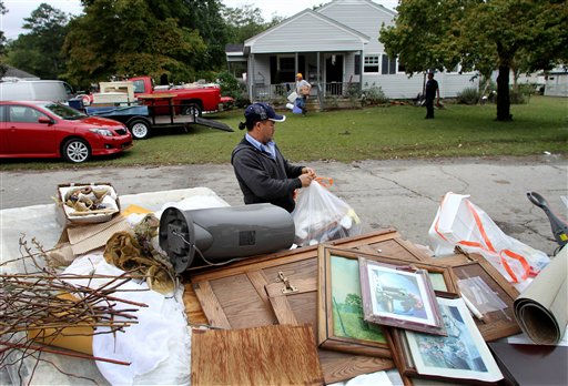 "<div class=""meta ""><span class=""caption-text "">Robert Delacruz removes damaged belongings from a home after floodwaters receded in Windsor, N.C., Monday, Oct. 4, 2010.  (AP Photo/ Jim R. Bounds)</span></div>"