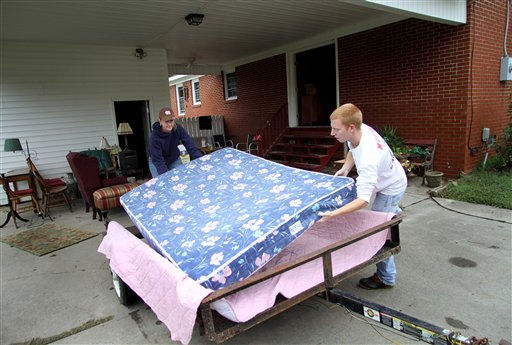 "<div class=""meta ""><span class=""caption-text "">Jordan Rose, right, and Amy Mizell move a mattress out of their grandmother's house after floodwaters receded in Windsor, N.C., Monday, Oct. 4, 2010.  (AP Photo/ Jim R. Bounds)</span></div>"