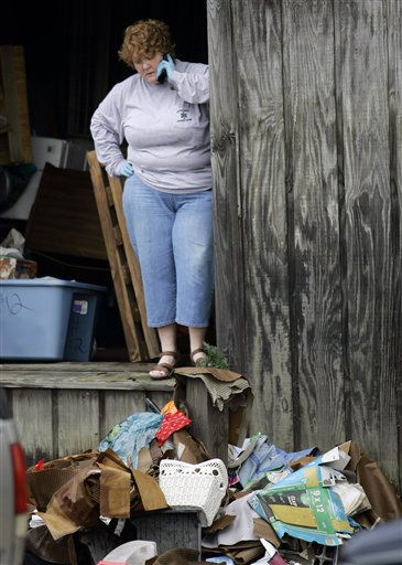 "<div class=""meta ""><span class=""caption-text "">Lynn Woodard speaks on a phone while cleaning out her storage unit after floodwaters receded in Windsor, N.C., Monday, Oct. 4, 2010.  (AP Photo/ Jim R. Bounds)</span></div>"