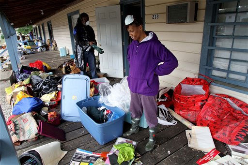 "<div class=""meta ""><span class=""caption-text "">Akosua Bandele, right, and Marvin Kelly clean out their storage unit after floodwaters receded in Windsor, N.C., Monday, Oct. 4, 2010. (AP Photo/ Jim R. Bounds)</span></div>"