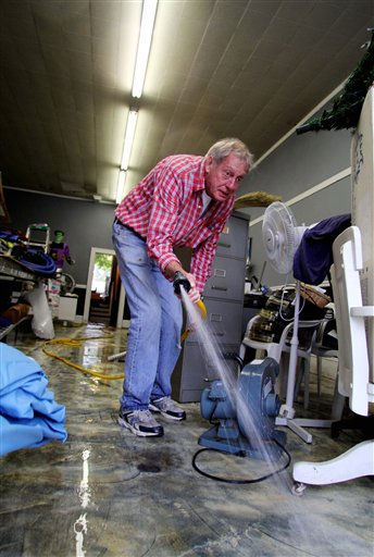 "<div class=""meta image-caption""><div class=""origin-logo origin-image ""><span></span></div><span class=""caption-text"">Ted Shaw cleans up The Pool & Spa Shop after floodwaters receded in Windsor, N.C., Sunday, Oct. 3, 2010.  (AP Photo/ Jim R. Bounds)</span></div>"