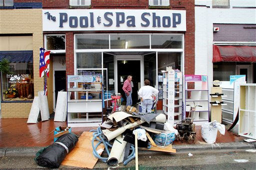 "<div class=""meta ""><span class=""caption-text "">Ted Shaw, left, and Kaye Thomas clean up The Pool & Spa Shop after floodwaters receded in Windsor, N.C., Sunday, Oct. 3, 2010.  (AP Photo/ Jim R. Bounds)</span></div>"