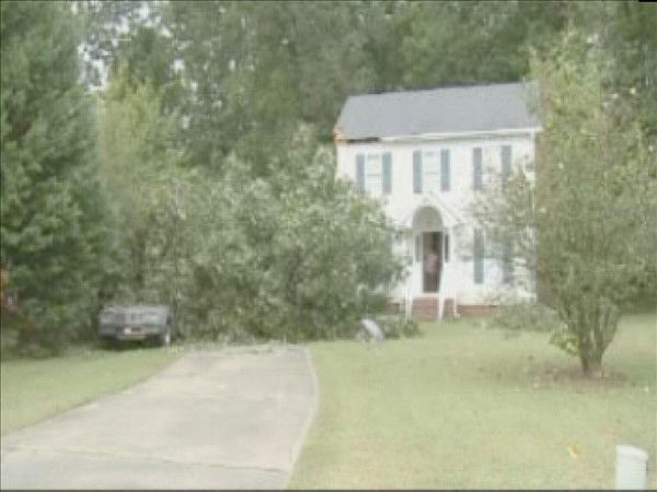 "<div class=""meta ""><span class=""caption-text "">A tree fell on this Garner home Thursday causing minor damage. (WTVD Photo/ Mat Mendez)</span></div>"