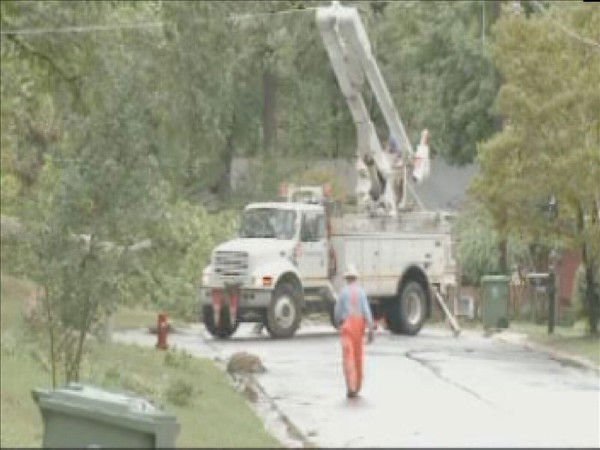 Workers remove a fallen tree in Cary that took out power lines. <span class=meta>(WTVD Photo&#47; Mat Mendez)</span>