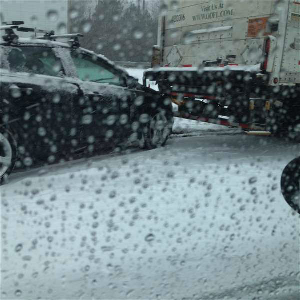 A winter storm snarled traffic and spawned dramatic scenes on roads around central North Carolina Wednesday. Many Good Samaritans and emergency workers came to the rescue of stranded drivers. <span class=meta>(Photo&#47;ABC11 iWitness photo)</span>