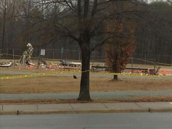 Aircraft went down into a softball field near a community center not far from Burlington-Alamance Regional Airport Wednesday morning. <span class=meta>(Photo&#47;ABC11 Reporter Anthony Wilson)</span>