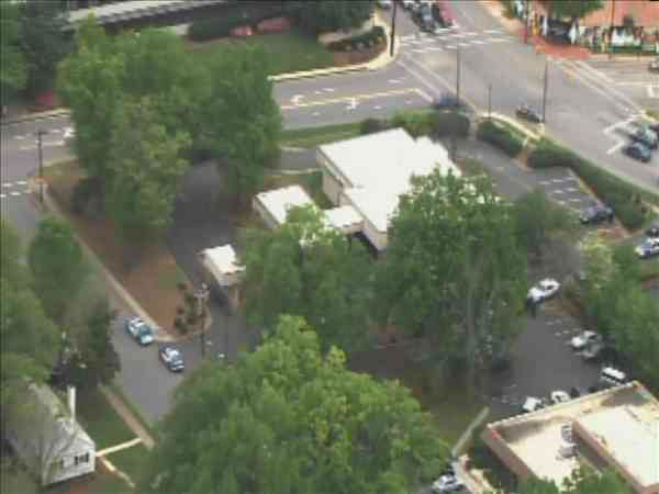 "<div class=""meta image-caption""><div class=""origin-logo origin-image ""><span></span></div><span class=""caption-text"">Authorities searching for suspect after Bank of America on Oberlin Road in Raleigh was robbed Thursday morning. (WTVD Photo/ Chopper 11 HD)</span></div>"