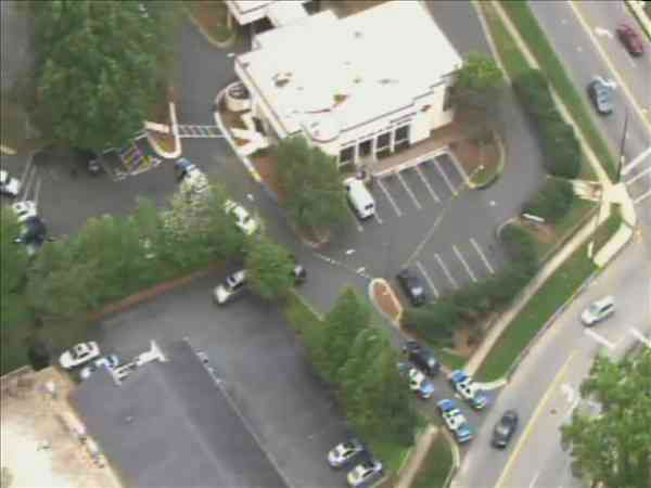 Authorities searching for suspect after Bank of America on Oberlin Road in Raleigh was robbed Thursday morning. <span class=meta>(WTVD Photo&#47; Chopper 11 HD)</span>