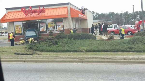 Authorities in Hope Mills, N.C. say a driver lost control and sideswiped another car before veering into the front of a Bojangles restaurant. No one was seriously injured. <span class=meta>(WTVD iWitness Photo)</span>