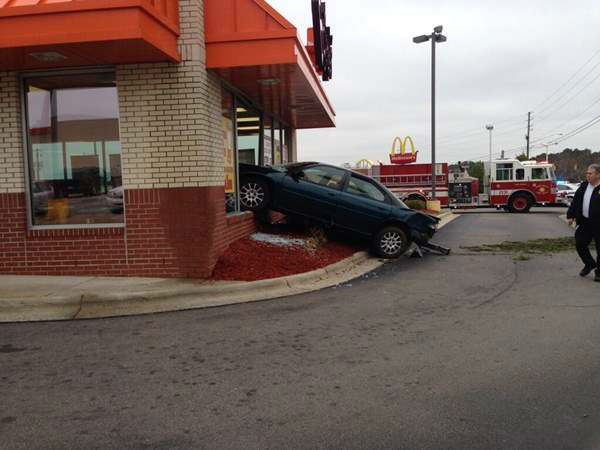 "<div class=""meta image-caption""><div class=""origin-logo origin-image ""><span></span></div><span class=""caption-text"">Authorities in Hope Mills, N.C. say a driver lost control and sideswiped another car before veering into the front of a Bojangles restaurant. No one was seriously injured. (WTVD Photo)</span></div>"