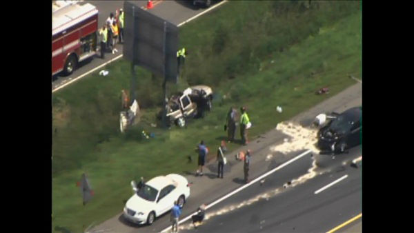 "<div class=""meta ""><span class=""caption-text "">Images from Chopper11 HD showed an overturn Ryder truck blocking the two southbound lanes of I-95 near mile marker 97 at U.S. 70 in Selma Wednesday morning. What appeared to be a gold Jeep was stopped under a road sign in the medium and had its roof torn off, while a black sedan with significant front and rear-end damage was stopped in the right hand lane. A third vehicle also appeared to be damaged. (WTVD Photo/ Chopper11 HD)</span></div>"