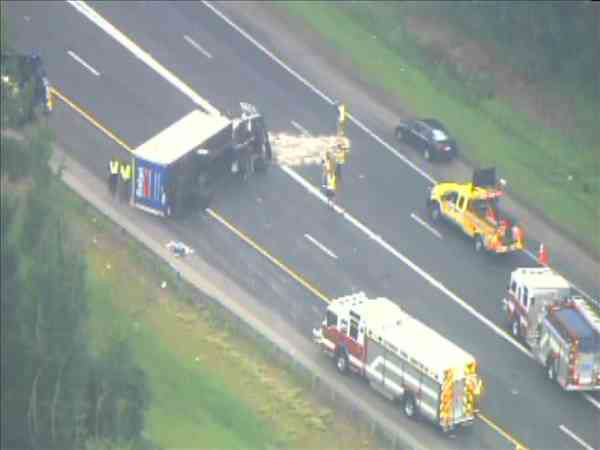"<div class=""meta ""><span class=""caption-text "">An overturned rental truck blocked several eastbound lanes on Interstate 40 Wednesday morning. (WTVD Photo/ Chopper11 HD)</span></div>"