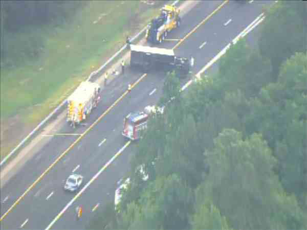 "<div class=""meta image-caption""><div class=""origin-logo origin-image ""><span></span></div><span class=""caption-text"">An overturned rental truck blocked several eastbound lanes on Interstate 40 Wednesday morning. (WTVD Photo/ Chopper11 HD)</span></div>"
