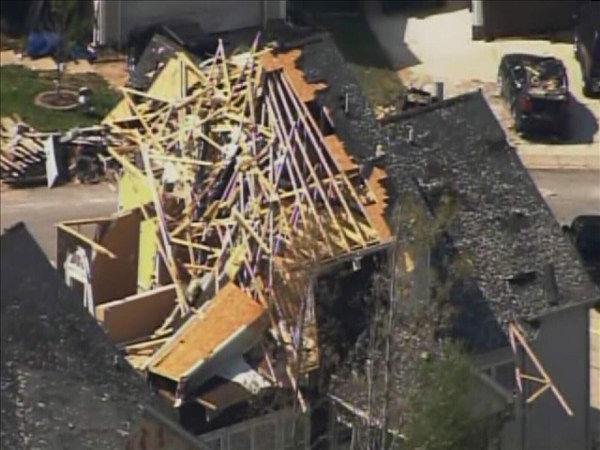 "<div class=""meta image-caption""><div class=""origin-logo origin-image ""><span></span></div><span class=""caption-text"">Homes in the north Raleigh area show tornado damage Tuesday. Many have blue tarps covering missing roof shingles. (WTVD Photo/ Chopper 11 HD)</span></div>"