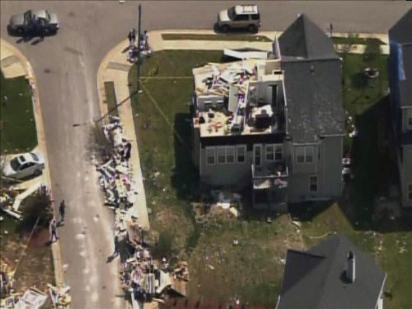 Homes in the north Raleigh area show tornado damage Tuesday. Many have blue tarps covering missing roof shingles. <span class=meta>(WTVD Photo&#47; Chopper 11 HD)</span>