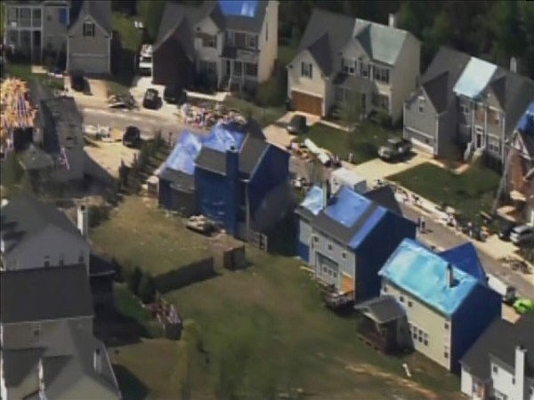 "<div class=""meta ""><span class=""caption-text "">Homes in the north Raleigh area show tornado damage Tuesday. Many have blue tarps covering missing roof shingles. (WTVD Photo/ Chopper 11 HD)</span></div>"