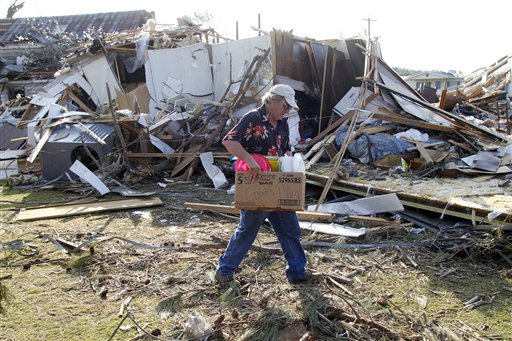 "<div class=""meta image-caption""><div class=""origin-logo origin-image ""><span></span></div><span class=""caption-text"">Ronald Jernigan collects his belongings from his destroyed home in Askewville, N.C., Tuesday, April 19, 2011. His home was flattened by a tornado on Saturday.  (AP Photo/ Jim R. Bounds)</span></div>"