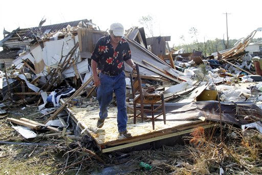 Ronald Jernigan collects his belongings from his destroyed home in Askewville, N.C., Tuesday, April 19, 2011. His home was flattened by a tornado on Saturday. <span class=meta>(AP Photo&#47; Jim R. Bounds)</span>