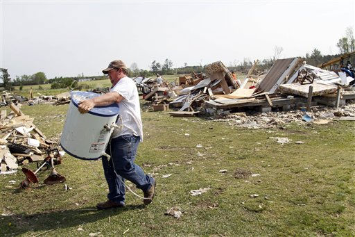 "<div class=""meta ""><span class=""caption-text "">Jessy Dulow removes debris from a destroyed home in Askewville, N.C., Tuesday, April 19, 2011 after tornados devastated the area Saturday.  (AP Photo/ Jim R. Bounds)</span></div>"