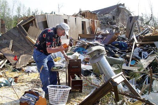 "<div class=""meta ""><span class=""caption-text "">Ronald Jernigan collects his belongings from his destroyed home in Askewville, N.C., Tuesday, April 19, 2011. His home was flattened by a tornado on Saturday.  (AP Photo/ Jim R. Bounds)</span></div>"