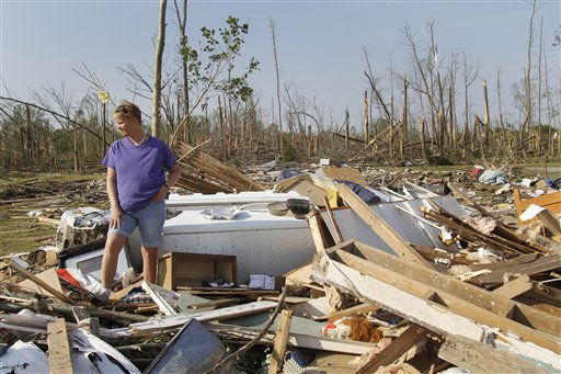 "<div class=""meta ""><span class=""caption-text "">Millie Jernigan collects her belongings from her destroyed home in Askewville, N.C., Tuesday, April 19, 2011 after tornados devastated the area Saturday.   (AP Photo/ Jim R. Bounds)</span></div>"