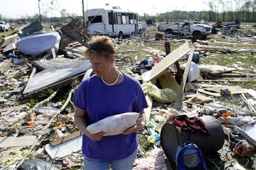 "<div class=""meta ""><span class=""caption-text "">Millie Jernigan collects her belongings from their destroyed home in Askewville, N.C., Tuesday, April 19, 2011 after tornados devastated the area Saturday.   (AP Photo/ Jim R. Bounds)</span></div>"
