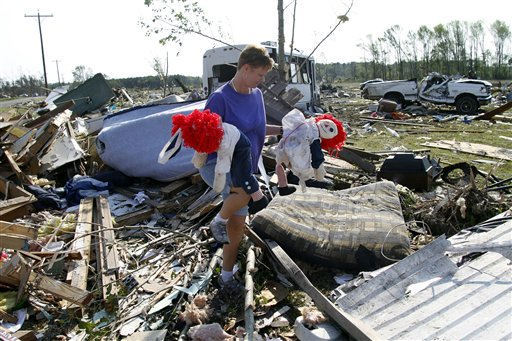 "<div class=""meta image-caption""><div class=""origin-logo origin-image ""><span></span></div><span class=""caption-text"">Millie Jernigan  collects her belongings from their destroyed home in Askewville, N.C., Tuesday, April 19, 2011 after tornados devastated the area Saturday.   (AP Photo/ Jim R. Bounds)</span></div>"