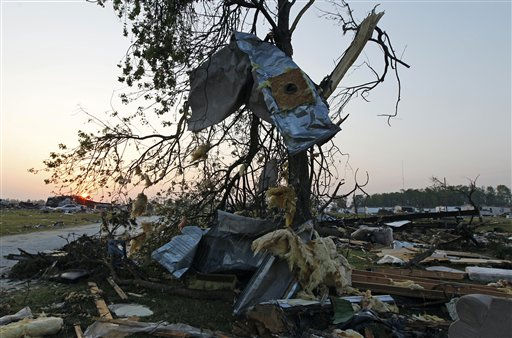 "<div class=""meta ""><span class=""caption-text "">Debris is scattered into a tree as the sun rises over a mobile home community in Dunn, N.C., Tuesday, April 19, 2011 after a tornado ripped through the area Saturday.  (AP Photo/ Chuck Burton)</span></div>"