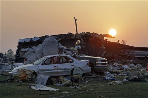 The sun rises over damaged cars and and a destroyed home at a mobile home community in Dunn, N.C., Tuesday, April 19, 2011 after a tornado ripped through the area Saturday.  <span class=meta>(AP Photo&#47; Chuck Burton)</span>