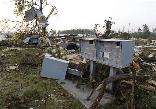 Damaged mailboxes stand near the entrance of at a severely damaged mobile home community in Dunn, N.C., Tuesday, April 19, 2011 after a tornado ripped through the area Saturday.  <span class=meta>(AP Photo&#47; Chuck Burton)</span>