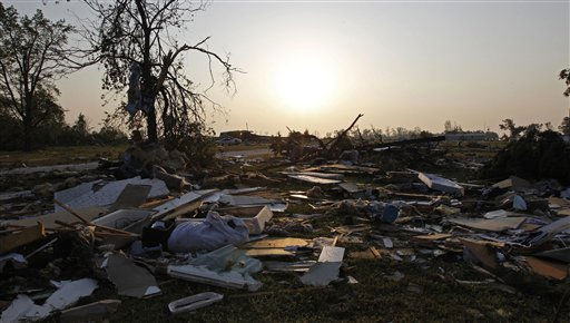 "<div class=""meta ""><span class=""caption-text "">The sun rises over a severely damaged mobile home community in Dunn, N.C., Tuesday, April 19, 2011 after a tornado ripped through the area Saturday.  (AP Photo/ Chuck Burton)</span></div>"