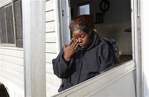 Terry Burgess wipes away a tear as she sits in the doorway of her damaged home at a mobile home community in Dunn, N.C., Tuesday, April 19, 2011, after a tornado ripped through the area Saturday.  <span class=meta>(AP Photo&#47; Chuck Burton)</span>