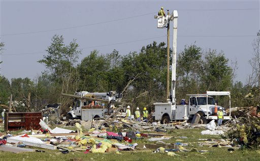 Electric workers restore power at a mobile home community in Dunn, N.C., Tuesday, April 19, 2011, after a tornado ripped through the area Saturday.  <span class=meta>(AP Photo&#47; Chuck Burton)</span>