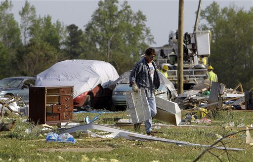 "<div class=""meta ""><span class=""caption-text "">An unidentified man removes debris from the remnants of a home at a mobile home community in Dunn, N.C., Tuesday, April 19, 2011, after a tornado ripped through the area Saturday.  (AP Photo/ Chuck Burton)</span></div>"