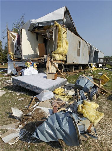"<div class=""meta ""><span class=""caption-text "">Personal belongings are scattered outside a destroyed home at a mobile home community in Dunn, N.C., Tuesday, April 19, 2011, after a tornado ripped through the area Saturday.  (AP Photo/ Chuck Burton)</span></div>"