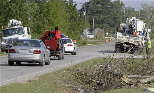 A resident rides with his belongings as he leaves a mobile home community in Dunn, N.C., Tuesday, April 19, 2011, after a tornado ripped through the area Saturday.  <span class=meta>(AP Photo&#47; Chuck Burton)</span>