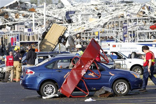 Emergency personnel work around a Lowes Home Improvement store after it was hit by a tornado in Sanford, N.C., Saturday, April 16, 2011.  <span class=meta>(AP Photo&#47; Jim R. Bounds)</span>