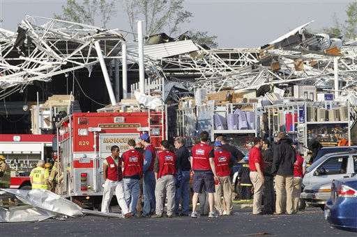 Lowes Home Improvement  employee stands in the parking lot of their store after it was hit by a tornado in Sanford, N.C., Saturday, April 16, 2011.  <span class=meta>(AP Photo&#47; Jim R. Bounds)</span>