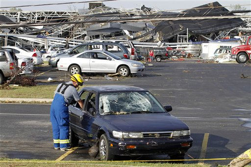Emergency personnel searches cars in the parking of Lowes Home Improvement  after it was hit by a tornado in Sanford, N.C., Saturday, April 16, 2011.  <span class=meta>(AP Photo&#47; Jim R. Bounds)</span>